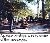 A passerby stops to read some of the messages.